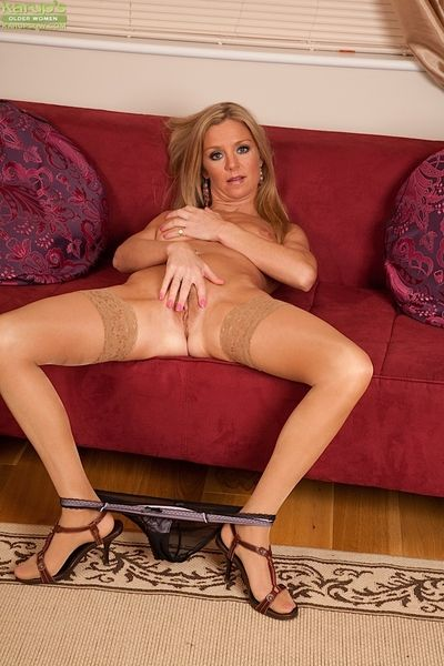 Nylon clad older blonde Euro woman Louise Dakotah freeing big tits from bra