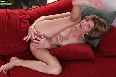Lewd granny Bossy Ryder getting naked and playing with a pink vibrator