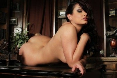 Curvaceous big racked brunette Aria Giovanni strips out of her black suit
