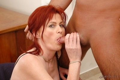 Stunning redhead granny gets her hairy pussy slammed by a younger guy