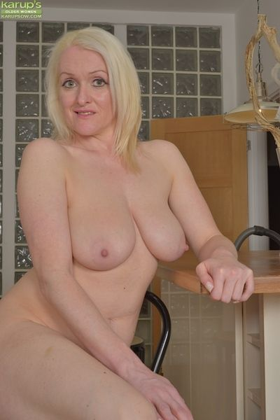 Blonde over 50 MILF Jade Wilson revealing nice all natural granny tits