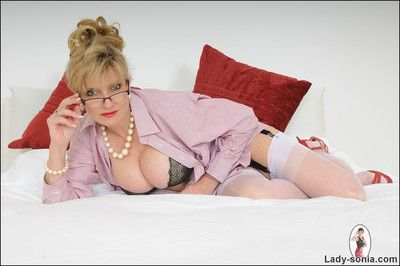Nylons and heels stunning mature minx lady sonia posing on bed