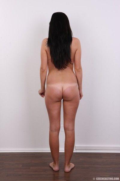 Brunette milf poses naked