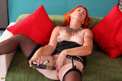 Red mature lady playing with her pussy