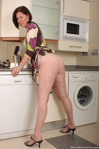 British milf julie lowers her panties