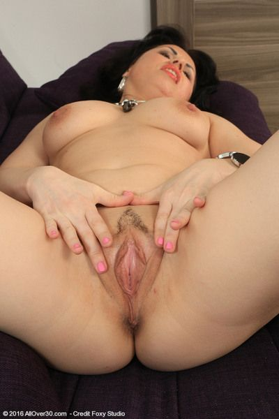Mature mama Nataly slips out of her dress