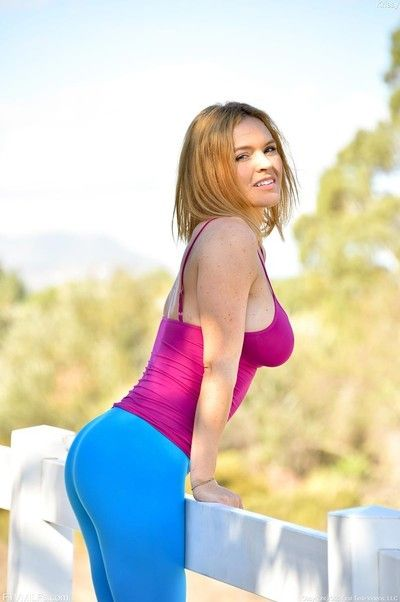 Busty cougar in yoga pants