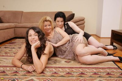 Three naughty old and young lesbians having fun