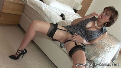 Milf lady sonia with a big black dildo