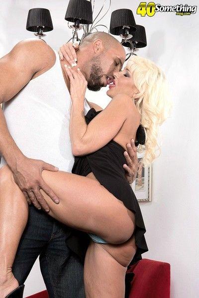 Blonde mature woman gives the best handjob