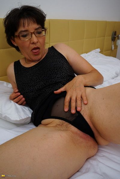 Hairy mature lady getting it on