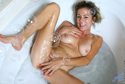 Experienced cougar vanessa enjoys her bubble bath with a black vibrator banging