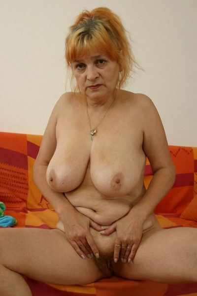 Czech amateur granny licking her big boobs