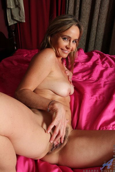 Sultry blonde mommy with full natural tits shows how naughty she