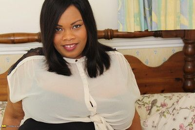 Big breasted black british bbw getting naughty