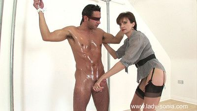 Sexual lady sonia fucks in rubber catsuit