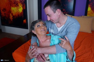 Naughty mature lady playing with her boy