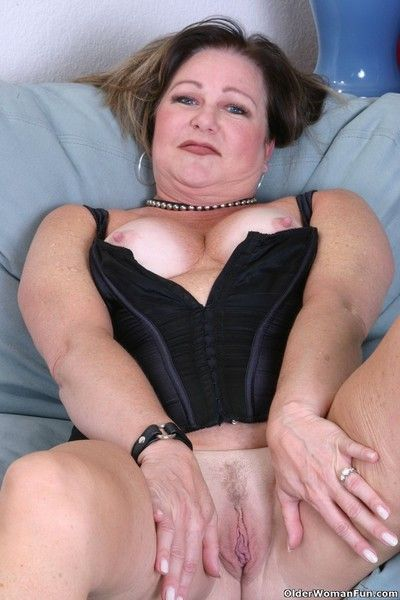 Grandma gilly shows off her suckable tits