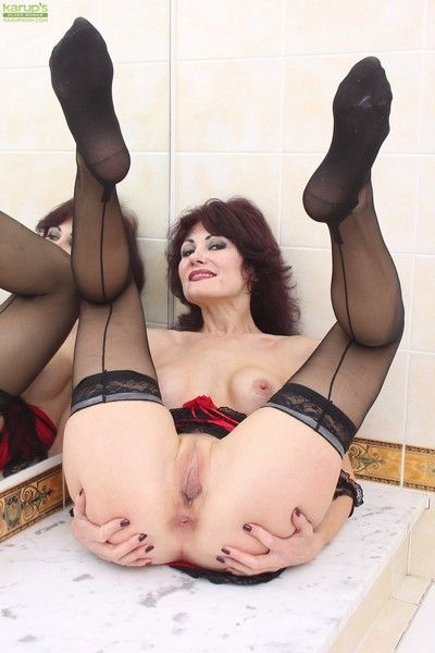 Fake tits melisa plays with her wet juicy pussy pnly in black stockings!