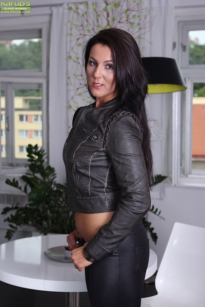 Brunette MILF Valentina Ross peels of black leather hot pants.