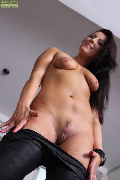 Brunette MILF Valentina Ross peels of black leather hot pants.