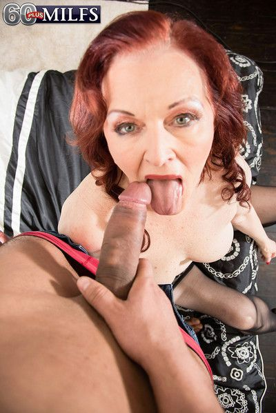 Redhead mature riding cock in hardcore sex pictures
