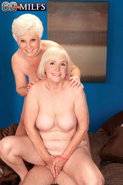 Two horny busty granny sluts sharing a stiff cock