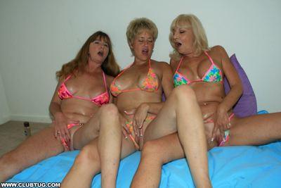 Three horny mature ladies in bikinis take turns jerking off a hard cock