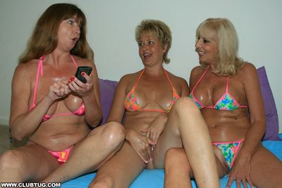 Three horny mature ladies in bikinis take turns jerking off a hard cock