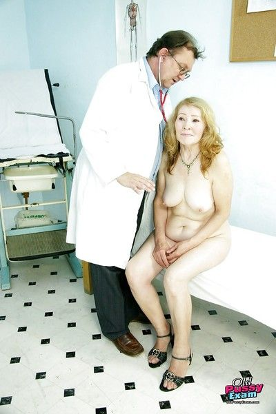Grannies moist cunt getting spread open wide at the Gyno\