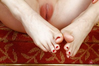 Older Euro broad Tina Kay sliding panties aside to expose pink pussy lips
