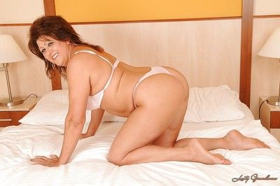 Chubby mature brunette taking off her lingerie and exposing her bush
