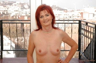 Mature yet sexy granny takes off her lingerie to show her hairy pussy