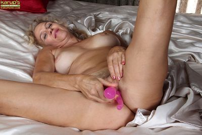 Amateur older mom Cally Jo showing hard nipples & toying with dildo on knees