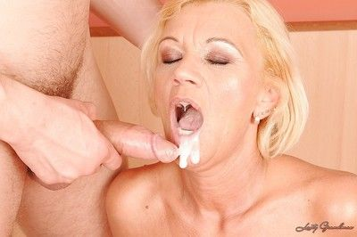 Lusty granny gets a facial after a hardcore fucking with a younger guy