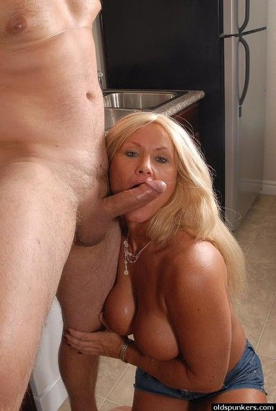 Older blonde slut Roxy taking creampie in kitchen from younger man