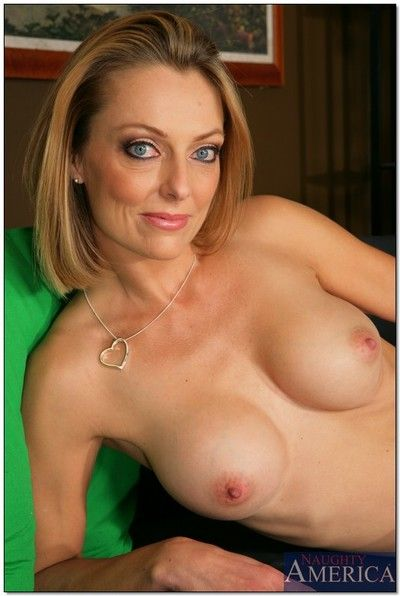 Busty mom Brenda James strips off pink panties and poses naked