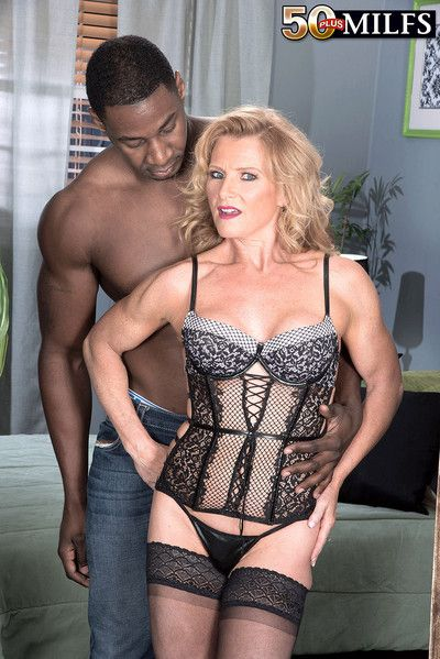 Mature blonde enjoys an interracial assfuck