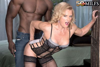 Mature blonde enjoys an interracial assfuck