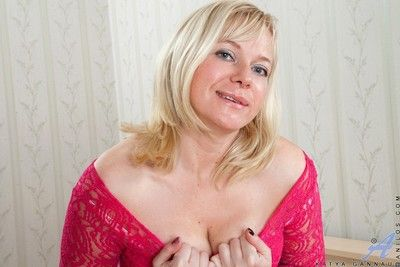 Mature blonde playing with dildo