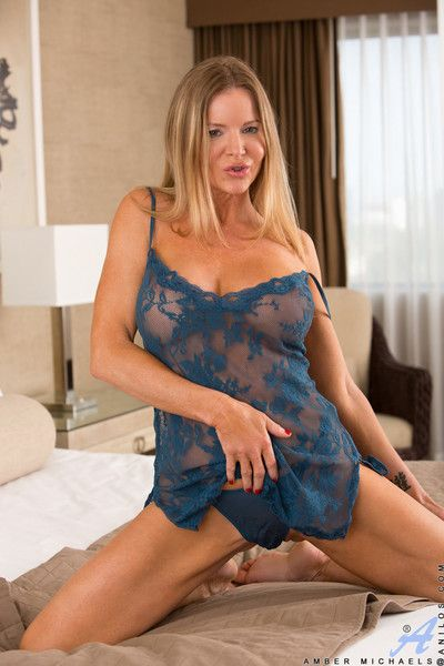 Mom next door in lingerie rides her magic wand and cums all over