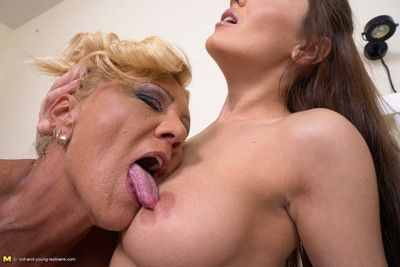 Hot babe having fun with a naughty mature lesbian