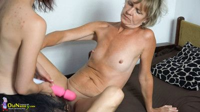 Old granny has fisting her ass from young sex girl