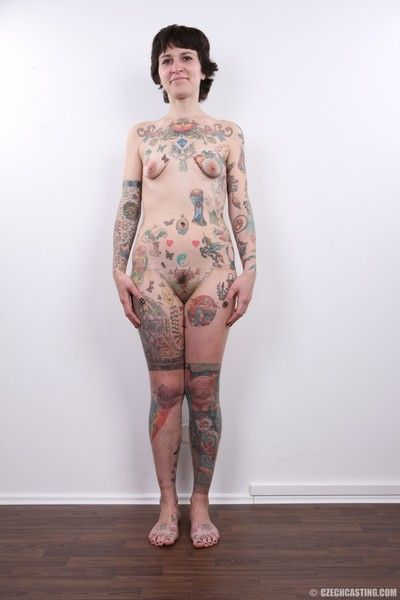 Mature tattooed slut poses