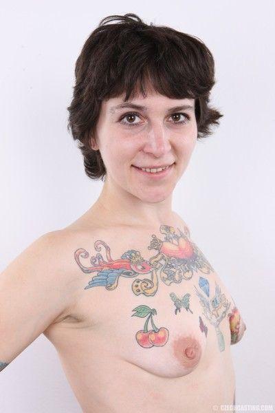Mature tattooed slut poses
