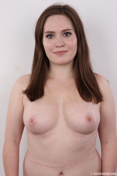 Mature brunette poses nude