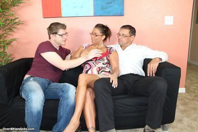 Busty milf Stacie jerking off her step son and her husband at the same time