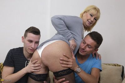 Horny mature lsut doing two guys