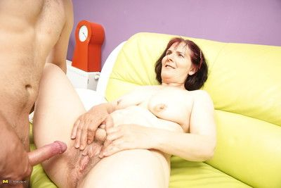 Horny mature slut doing her younger lover
