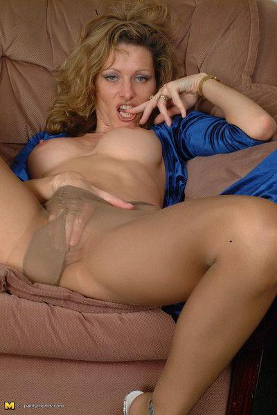 Hot kinky milf spreading her long legs in pantyhose